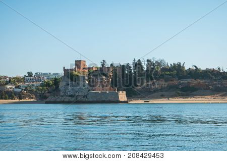 The magnificent Fort of Sao Joao do Arade in Ferragudo sometimes referred to as the Castle of Arade viewed from the Port of Portimao.