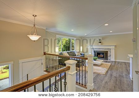 Second Floor Landing Living Space With A White Fireplace