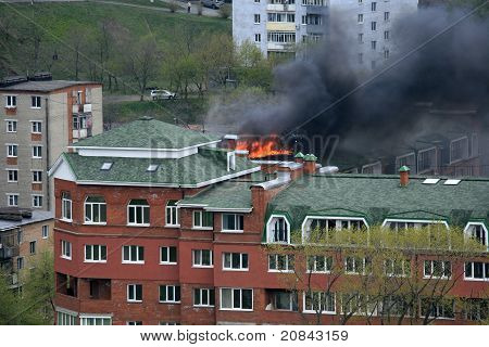 Open Fire On Roof Of A Residential Building