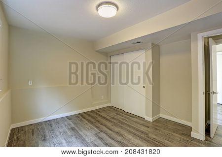Bright Beige Empty Room With Grey Hardwood Floor