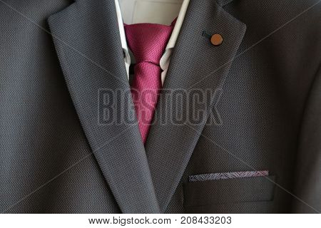 Detail closeup close-up of suit jacket lapel button hole fabric selective focus