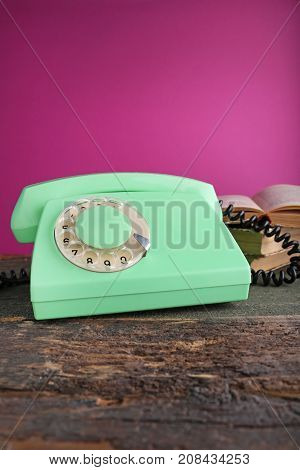 Green Retro Telephone On Grey Wooden Table