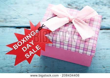 Red Sale Tags With Gift Box And Inscription Boxing Day Sale On Blue Wooden Table