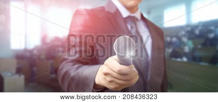 Businessman With Microphones In Hand .