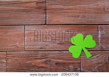 Green Paper Clover Leaf On A Brown Wooden Table