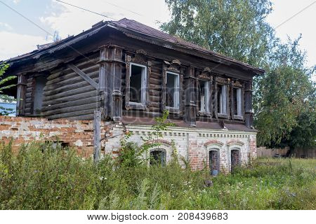Ruined Old Abandoned House With A Blown-up Wall