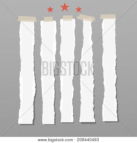 White ripped strips, paper with red stars for note or text stuck with sticky tape on brown background