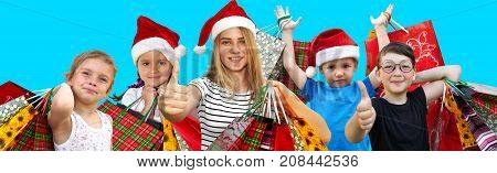 Little children in fur-caps with shopping bags. Sales and Christmas