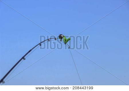 The bell on the fishing rod. spinning equipment. selective focus