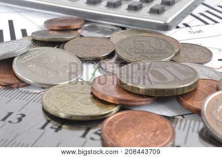 Financial background with money calculator and graph