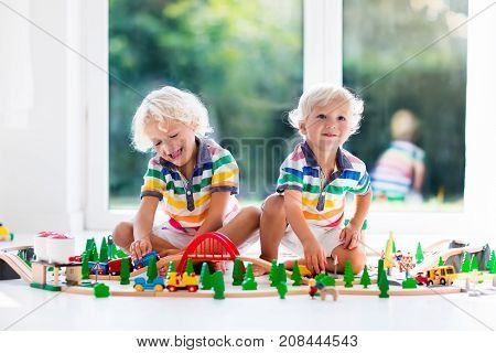 Children Play Wiht Toy Train. Kids Wooden Railway.