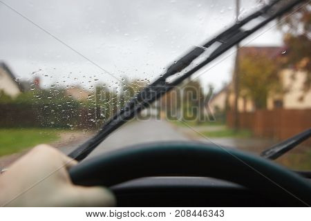 driving car in rainy day windshield cleaners working