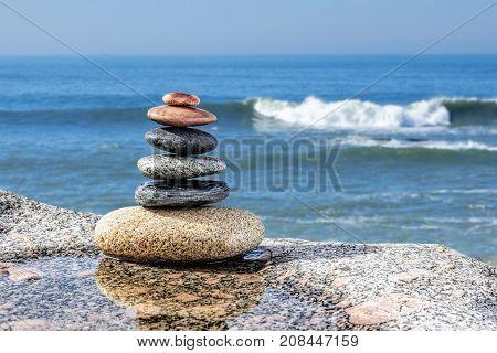 Zen Balancing Pebbles on sea background, Harmony and Balance