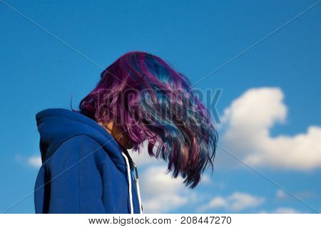 The girl's hair extreme colors, pink, blue