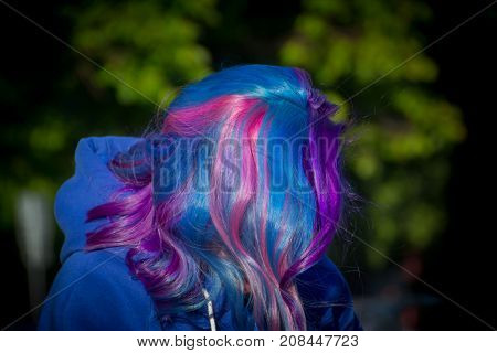 Extreme hair girl in the wind, pink, blue, purple