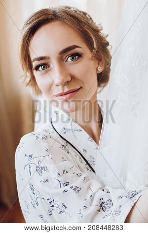 Beautiful Happy Bride Smiling, Standing In Silk Robe At Her Luxury Wedding Dress. Happy Moments. Mar