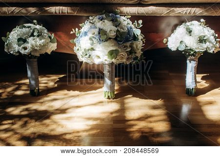 Beautiful White And Blue Roses Wedding Bouquets For Bride And Bridesmaids Closeup, Fresh White Flowe