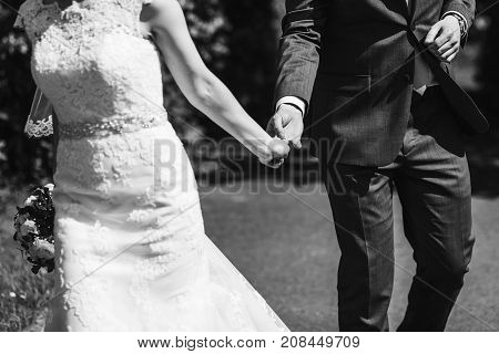 Romantic Touch. Gorgeous Bride And Groom Embracing And Holding Hands. Black White Photo. Romantic Mo