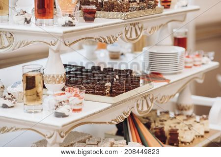 Delicious Cakes Cupcakes And Desserts Sweet On Table At Wedding Reception In Restaurant. Luxury Cate