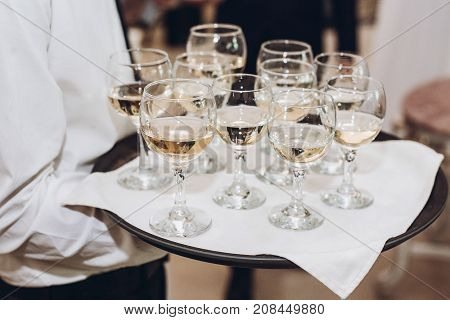 Glasses Of Champagne Or Wine On Tray. Waiter Serving Champagne At Wedding Reception In Restaurant. L