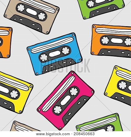 Seamless pattern with retro audio cassette. Hand drawn old audio tapes in 80s - 90s style