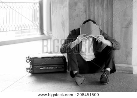 Stressed Asian Businessman Bankrupt With Sitting At Outdoor And Book Close Face Black And White Pict