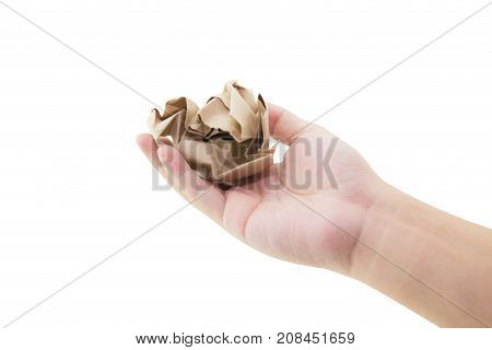 Hand holding crumpled paper isolated on white background.