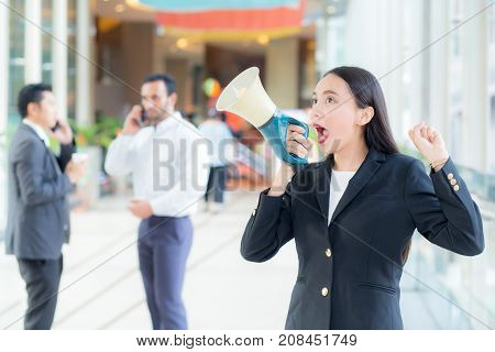 Young Business Woman Working At The Office, .shouting And Yelling In Megaphone