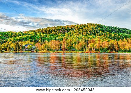 Chicoutimi River In Saguenay, Quebec, Canada With Riverfront Houses And Forest During Sunset With Co