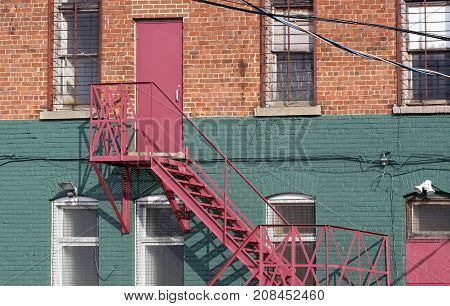 Fire escape and staircase at back of brick building