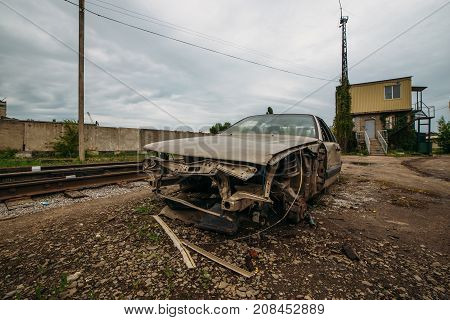 Aftermath of accident. Car crashed by train. Crashed car near railroad