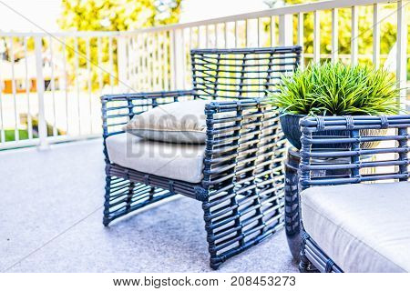 Chairs And Green Plant In New House Closeup With Decorations On Balcony In Staging Model Home Or Apa