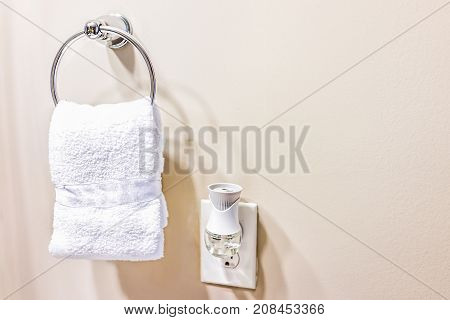 Staging Modern Bathroom With One Small White Towel Hanging On Rack In Model Home, Apartment Or House