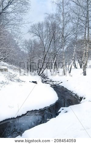 A Snow Covered Stream In The Forest