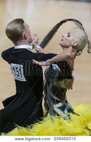 Minsk Belarus-October 7 2017: Dance Couple of Lioli Yury and Berestova Oxana Performs Adults European Standard Program on WDSF International Capital Cup Minsk- 2017 in October 7 2017 in Minsk Belarus.