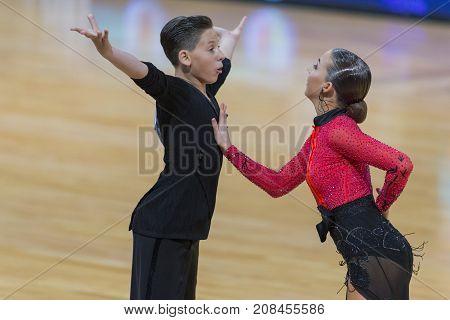 Minsk Belarus-October 7 2017: Dance Couple Of Sokol Artem and Kireeva Polina Performs Youth-2 Latin-American Program on WDSF International Capital Cup MinskOctober 72017 MinskBelarus.