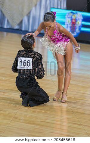 Minsk Belarus-October 7 2017: Dance Couple Of Samadashvili Avtandil and Gogishvili Elene Performs Youth-2 Latin-American Program on WDSF International Capital Cup MinskOctober 72017 MinskBelarus.