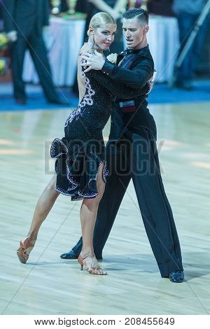 MinskBelarus-October 72017:Pro-Am Dance Couple of Ivan Sorokin and Elena Yurgeneva Performs Pro-Am International Scholarship Latin-American Program on WDSF International Capital Cup MinskOctober 72017 MinskBelarus