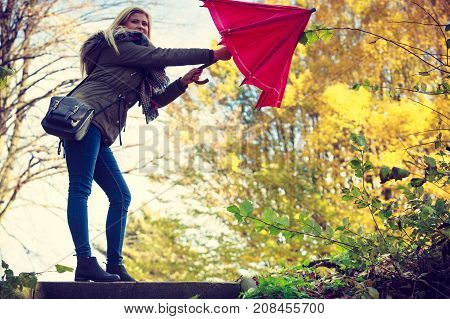 Woman Walking In Park With Umbrella, Strong Wind