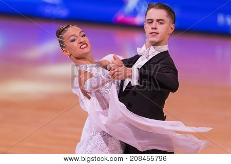 Minsk Belarus-October 7 2017: Dance Couple of Magdisyuk Andrey and Staricyna Nataliya Nataliya Performs Adults European Standard Program on WDSF International Capital Cup Minsk- 2017 in October 7 2017 in Minsk Belarus