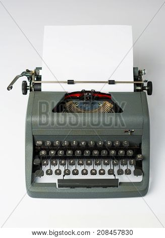 Antique Typewriter on White Background with Paper in Perspective