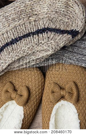 Stack of Handmade Warm Knitted Socks From Rough Wool Yarn Fluffy Fir Slippers Top View. Winter Autumn Eco Fashion Kinfolk Style. Natural Materials.