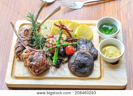 Grilled lamb chops steak with rosemary and grill vegetable