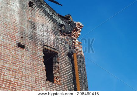 brick building after firer destroyed sinister damaged roof