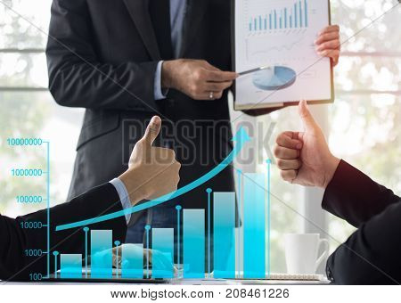 businessman show thumb and admire in meeting room mixed media