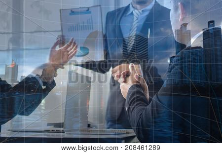 Double exposure of businessman clap hand and talking with colleagues about finance and success of company and presentations concept as teamwork and team of business