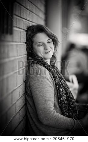Portrait of Woman feeling Fulfilled and Gratified - Natural Light in Black and White