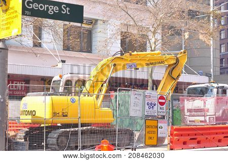 Sydney Australia - August 14 2017: George Street footpath closure. Bright yellow road sign indicating pedestrian detour construction access only and road work area.