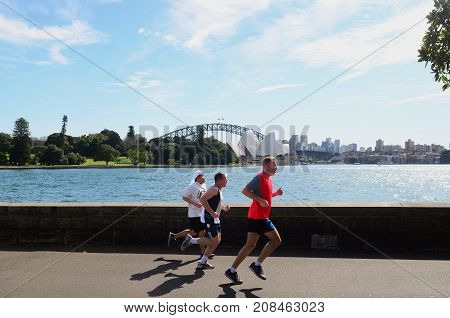 SYDNEY - AUGUST 11 2017:Australian men runs near the Opera House. Approximately 35% of the Australian population participated at least in one physical recreation activity.