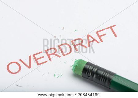Word 'overdraft' With Worn Pencil Eraser And Shavings